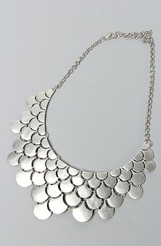 This would totally look fab under a collared blouse! The Fish Scale Necklace in Silver