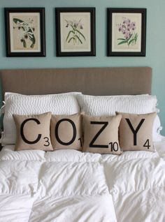COZY Letter Pillows - Look easy enough to DIY! Sew up a burlap pillow cover, print off letter stencils, and use fabric paint to make the letters!