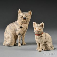 """Auction: American Furniture & decorative Arts, Boston, March 2, 2014 Two Painted Mohair Toys striped cat, in the late 19th and early 20th century, painted stripes on the surface of woven mohair, with glass eyes, whiskers, horsehair, collars with brass bells, the big cat is a """"crumb"""" when the ring pulled the cat meows, (mouth does not open), ht.18,4 cm and 13.3 cm.Продан за $554"""
