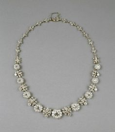 This necklace is a splendid example of Tiffany & Co.'s jewelry production around the turn of the 20th century, when the company was famous for its lavish use of diamonds. Composed of stylized fleurs-de-lys and rosettes, this necklace recalls the diamond jewelry of the 18th century. There are 265 diamonds set in a gold mounting faced with platinum. Walters Art Museum.