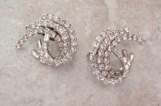 Rhinestone Swirl Earrings Silver Tone Clip On Crystal Baguette Chatons Vintage 101614GL by cutterstone on Etsy #rhinestoneearrings #swirl #vintagejewelry #crystalearrings #fashion #bridal