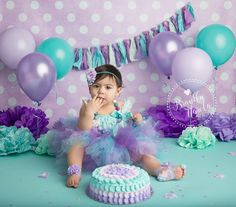 Baby girl wearing tutu in purple and blue themed Baby Cake Smash Photo by Brandie Narola Photography