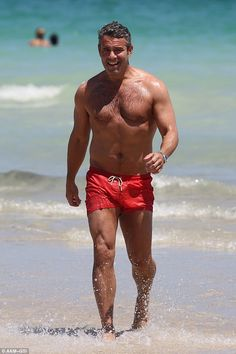 Welcome to Miami: Andy Cohen, 46, enjoys a shirtless day at the beach in Miami on Saturday...