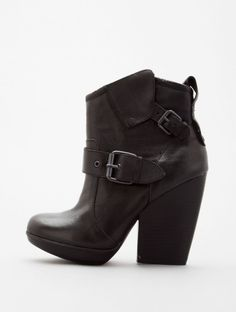 Rawr! Sassy fine hard buckle ankle boots.  These would look hot paired with a soft romantic lacy dress and a leather biker jacket. Leather and lace!