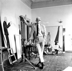 English artist David Hockney in a studio with some of his work, circa 1967. (Tony Evans, Getty Images)