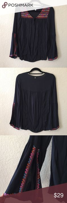 Billabong Boho Top Black boho top with embroidered detail on the sleeves and front area. Has pomp pomp trim (please not pomp pomp's are uneven but none are missing) . Has split bell sleeves. Very slight fading since it's dark color and cotton. Billabong Tops