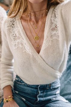 Wrap beige sweater, blue jeans and layered jewelry #springfashion