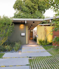 Love the yellow groundcover coordination with the yellow wall. Landscape designer Bernard Trainor masterminds a seamless garden to surround a Silicon Valley Eichler.
