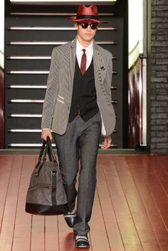 John Varvatos Spring 2013 Menswear Collection. Models are accessorized with a modern day fedora