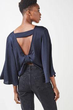 http://us.topshop.com/en/tsus/product/clothing-70483/tops-70498/satin-knot-back-blouse-6138651?bi=20