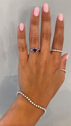 The Pembroke is simply exquisite in all her nature-inspired pizzaz. She is created in a bright platinum metal. An amazing round 1.50ct blue sapphire sits like a queen in the center of this band - set in a classic 4-prong setting, but with a leafy twist. And to adorn the diamond you will see four hand engraved leaves that softly caress the heart of this ring. Setting only cost: 14k Rose, White, or Yellow Gold setting $990 18k Rose, White, or Yellow Gold setting $1150 Platinum setting $1390… Split Shank Engagement Rings, Engagement Ring Shapes, Gemstone Engagement Rings, Gemstone Rings, Ken And Dana Designs, Wedding Jewelry, Wedding Rings, Platinum Metal, Engagement Inspiration
