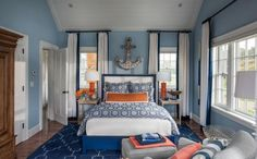 Add a pop of color to the monochromatic color scheme  of a room. Love this blue with the orange. Something to think about.