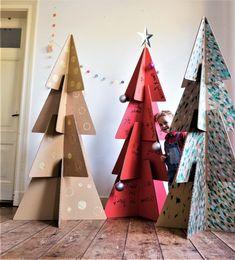 10 DIY pour fabriquer un sapin en carton Cardboard Christmas Tree, Christmas Tree Crafts, Green Christmas, Xmas Tree, Christmas Holidays, Christmas Decorations, Holiday Decor, Cardboard Tree, Tree Tree
