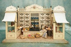 "30""w. (76 cm.) Wonderful German wooden toy grocery store with rare wind-up awnings"