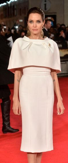 Angelina Jolie looks gorgeous in a cape dress on the red carpet