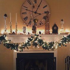 Christmas mantel decor. Burlap, pinecones and glitter.