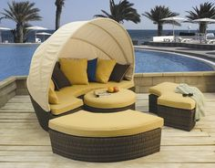 """This beautiful """"All Weather"""" vinyl/resin aluminum frame daybed offers the option of an oversized lounger transformed to comfortable seating for eight. Call me. Outdoor Fabric, Indoor Outdoor, Outdoor Decor, Curved Bench, Canvas Canopy, Round Ottoman, Daybed, Coastal Decor, My Dream Home"""