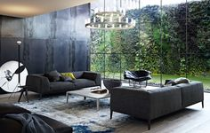 Amazing Poliform Metropolitan Sofa & Wallace chair. Nice steel wall too.