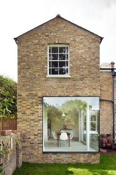contemporary architecture, exposed bricks, Eames chairs & a... (via Bloglovin.com ) #contemporaryarchitecture