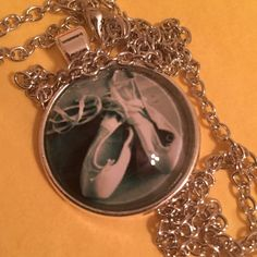 BALLET SLIPPERS Silver tone. Alloy glass about 20 inches. Medallion about an inch. Jewelry Necklaces