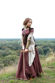 A Girl In A Medieval Costume With A Bow And Arrow