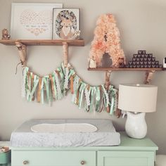 Woodland themed nursery: baby girl, pottery barn, target, land of nod, street find changing table, refinished, diy shelves, homegoods
