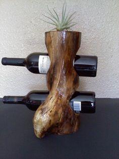 Weinregal selber bauen rustikales Weinregal aus Baumstamm Source by freshideen