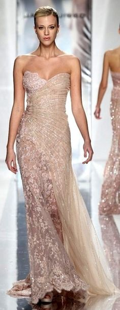 I don't usually like strapless but this Jack Guisso lace gown is exquisite!