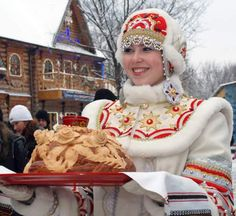 Russian girl in traditional winter attire greeting guests with a festive loaf. #Russia
