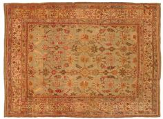 Antique Oushak rug from Esmaili Rugs Collection: Oushak rugs are named after the city of Uşak, Turkey, which was a center of rug production beginning in the Ottoman Empire and continuing to this day. In the past these magnificent rugs were known simply as Anatolian, but today collectors and scholars are able to more specifically classify them apart from other Turkish rugs. Oushak rugs with a soft green field, like this one, are highly sought after collection pieces. Hand knotted from soft…