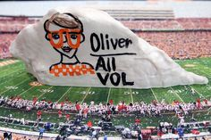 Her son was All Vol. So she wrote it on a Rock. The UT Dry Erase Rock by College Replicas.