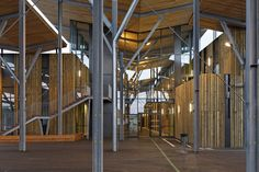 Image 15 of 17 from gallery of College Aime Cesaire / Patrick Arotcharen architecte. Photograph by Vincent Monthiers Metal Cladding, Wooden Canopy, Pine Forest, School Architecture, Entrance, College, Landscape, Gallery, Photograph