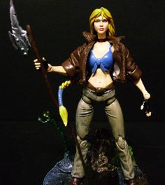 this is a marvel legends Elsa Bloodstone Custom Action Figure she was made by figure realmer boskoes he used a buffy the vampire slayer figure for the body, invisible woman head, and emma frost upper body happy pinning
