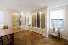 NewWall House Toronto Wallpaper Showroom - chevron flooring, white walls, crown moulding, wallpaper wings