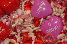Valentine's sensory ideas, including red sensory bags with different substances inside.