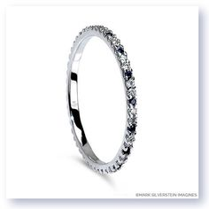 Uniquely sophisticated yet classic and refined, this simple eternity band features sapphires and white diamonds pavé set in polished 18K white gold.  Thin and delicate the piece is built to last.