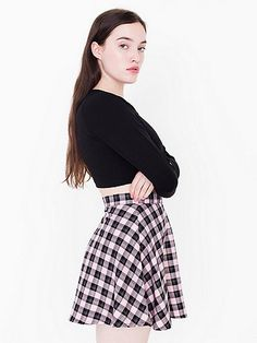 Classic circle skirt featuring an A-line silhouette in plaid prints. Includes an invisible zipper and button closure.