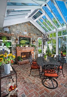 If you have a sunroom or a screened in/three season porch, I consider you lucky. Outdoor living without mosquitos, rain or wind? When we were looking for our first house last spring, as dutiful HGTVers, we made a. Veranda Design, Conservatory Design, Patio Design, Outdoor Rooms, Outdoor Living, Outdoor Decor, Diy Home Decor Rustic, Enclosed Patio, Brick Flooring