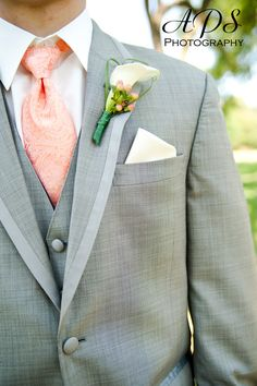 Gray Is In! And I Love It! A unique touch was the tie. The orange tie matched the flowers while the groomsmen had green ties to match the bridesmaid dresses. It looked very sharp!