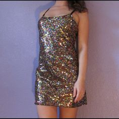FREE PEOPLE sequin mesh slip dress GORGEOUS Intimately free people multicolor sequin mesh slip mini dress.  100% nylon. Great stretch, adjustable straps. Size medium. Underarm to underarm 16 inches, shoulder to bottom 31. Gently worn a few times. Very sexy!!! Free People Dresses Mini