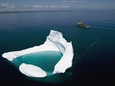 Towing iceberg away from oil platform