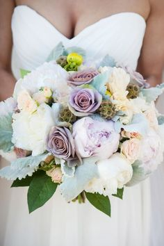 Wedding Bouquet Ideas: Lavender-Hued Roses & Ranunculus - http://www.diyweddingsmag.com/wedding-bouquet-ideas-lavender-hued-roses-rancu/ #weddingbouquets | Photography: Kathy Blanchard Photography | Floral Design: Southern Blooms by Pat's Floral Designs