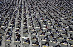 Students take an examination on an open-air playground at a high school in Yichuan, China, on April 11, 2015.