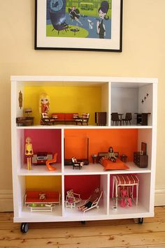 Repurposed colorful bookcase dollhouse. When we have a bigger place - I've always wanted to do this.  Hopefully it'll happen before she's too old to care.
