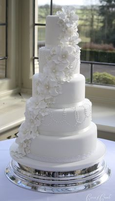 https://flic.kr/p/bA58ir   5 petal flower cascade cake   Delivered to stunning Kilworth House in Leicester this morning. The bride designed the cake based on a Planet Cake design but with a pearl necklace effect on 2 of the tiers. The pearls were painted with lustre and the flowers were dusted with lustre dust. Also made 130 cookies for the brides favours. They took almost as long as the cake to make !  The venue said that the cake for last weeks wedding was provided by The Little Venice ...