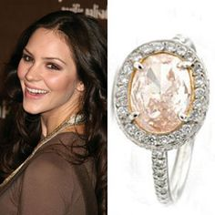 Katharine McPhee's ring, from hubby Nick Cokas, is an oval-cut yellow diamond surrounded by pink pave diamonds. The ring is set in platinum and estimated to be worth $100,000.See photos of Katharine McPhee's wedding.