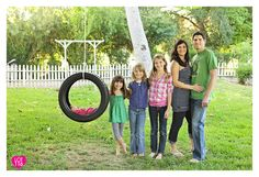 What a fun family picture with baby in the tire!