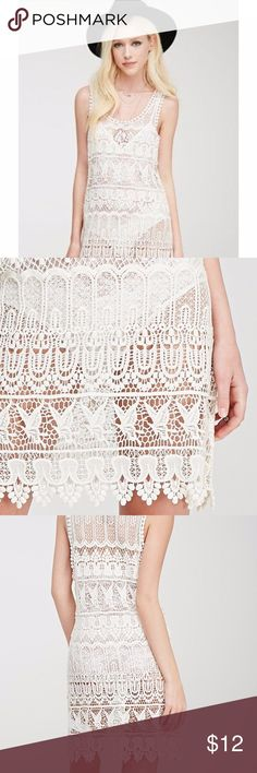 """Forever-21-Boho-Cream-Ornate-Crochet-Tunic-Dress New with tag .  Size :Medium  This sleeveless tunic dress! It's crochet construction features stunning and intricate ornate patterns that we think look perfect thrown over a tank, cami, or even your swimsuit. Round neckline, unlined Lightweight knit. 100% cotton. Measures: 34.5"""" full length, 32"""" chest, 36"""" waist  FREE GIFT INCLUDED FOREVER 21 Dresses Mini"""