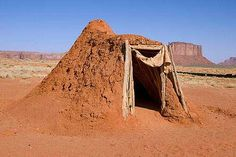 Navajo Tribe, Earth-Walled Dugout, Native American Folk Hogan, supported by conical frame of timbers