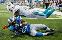 Theo Riddick catches a fourth quarter touch down : Must-see photos from NFL Week 10